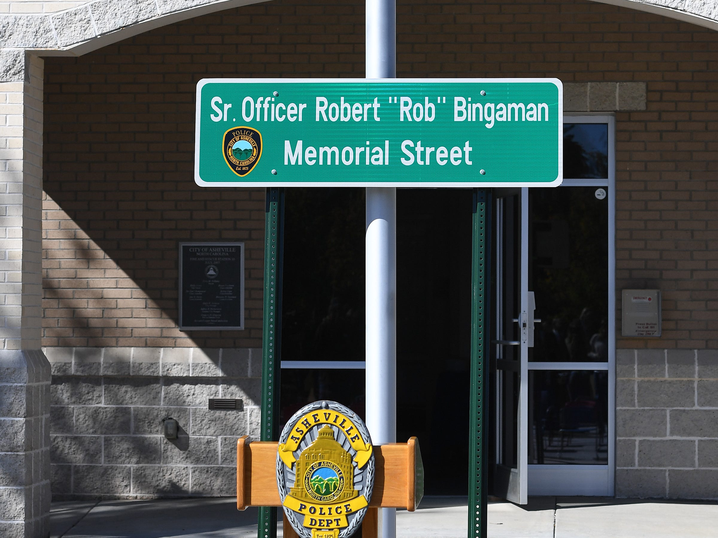 A sign that will be used to dedicate a portion of Old Haywood Road to Asheville police officer Robert Bingaman is on display before the start of a ceremony at the Traffic Safety Office on the five-year-anniversary of his death on Oct. 29, 2018.