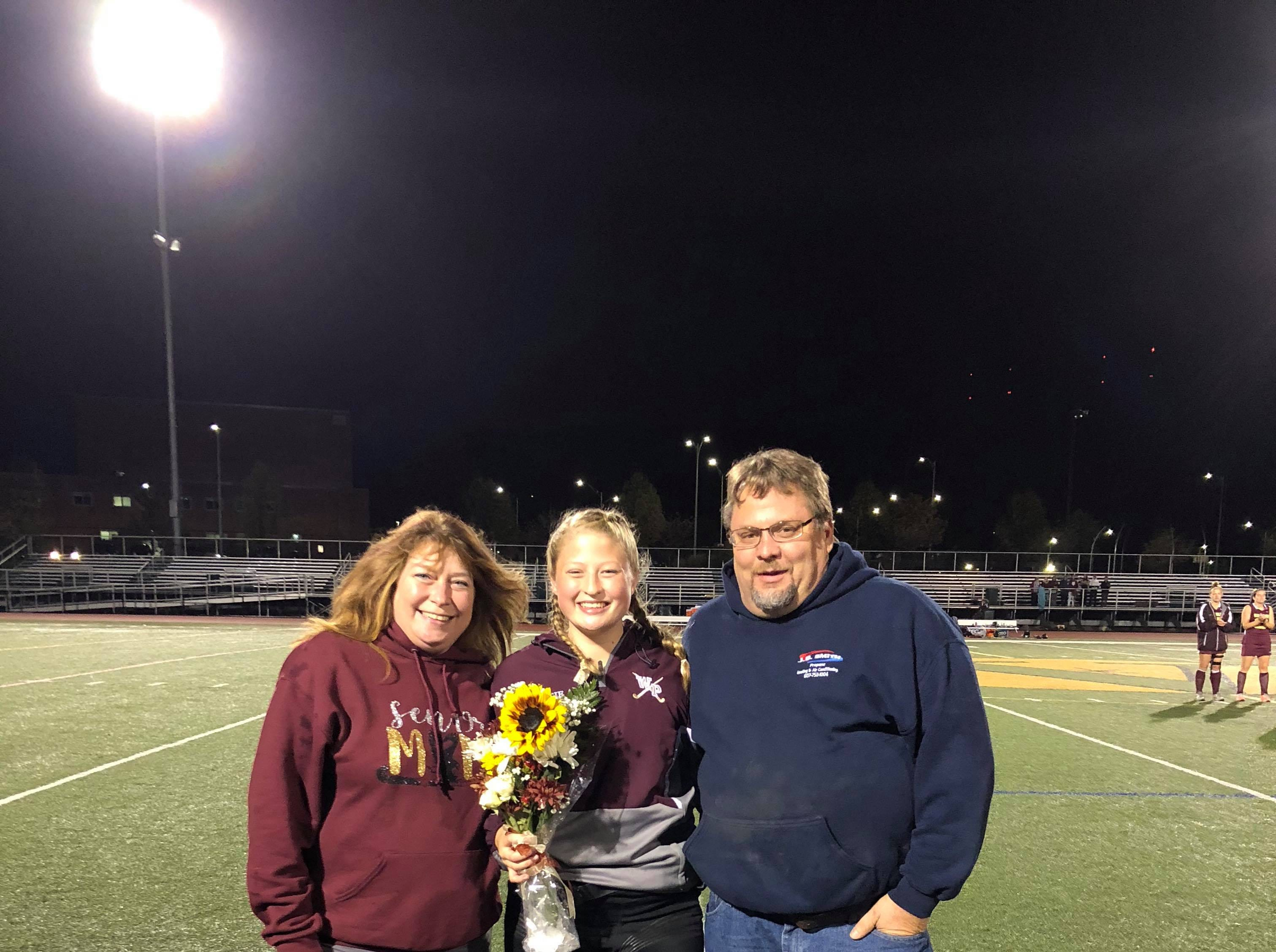 Katie Cafferty (#80), Jennifer and Todd Cafferty