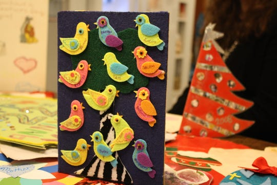 Vestal artist Ramona Kacyvenski decorated a Christmas card for her mother, Marlene Stacconi, with felt birds. Each of Stacconi's grandchildren's name was written on each bird.