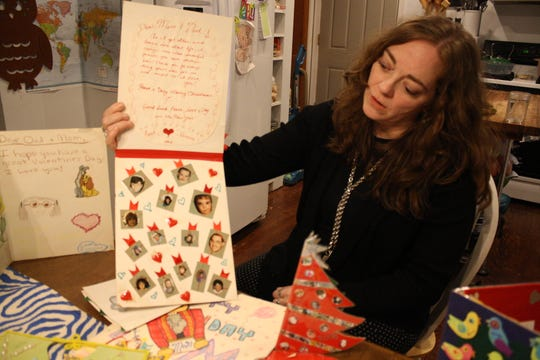 Vestal artist Ramona Kacyvenski holds us a Christmas card she made for her parents.