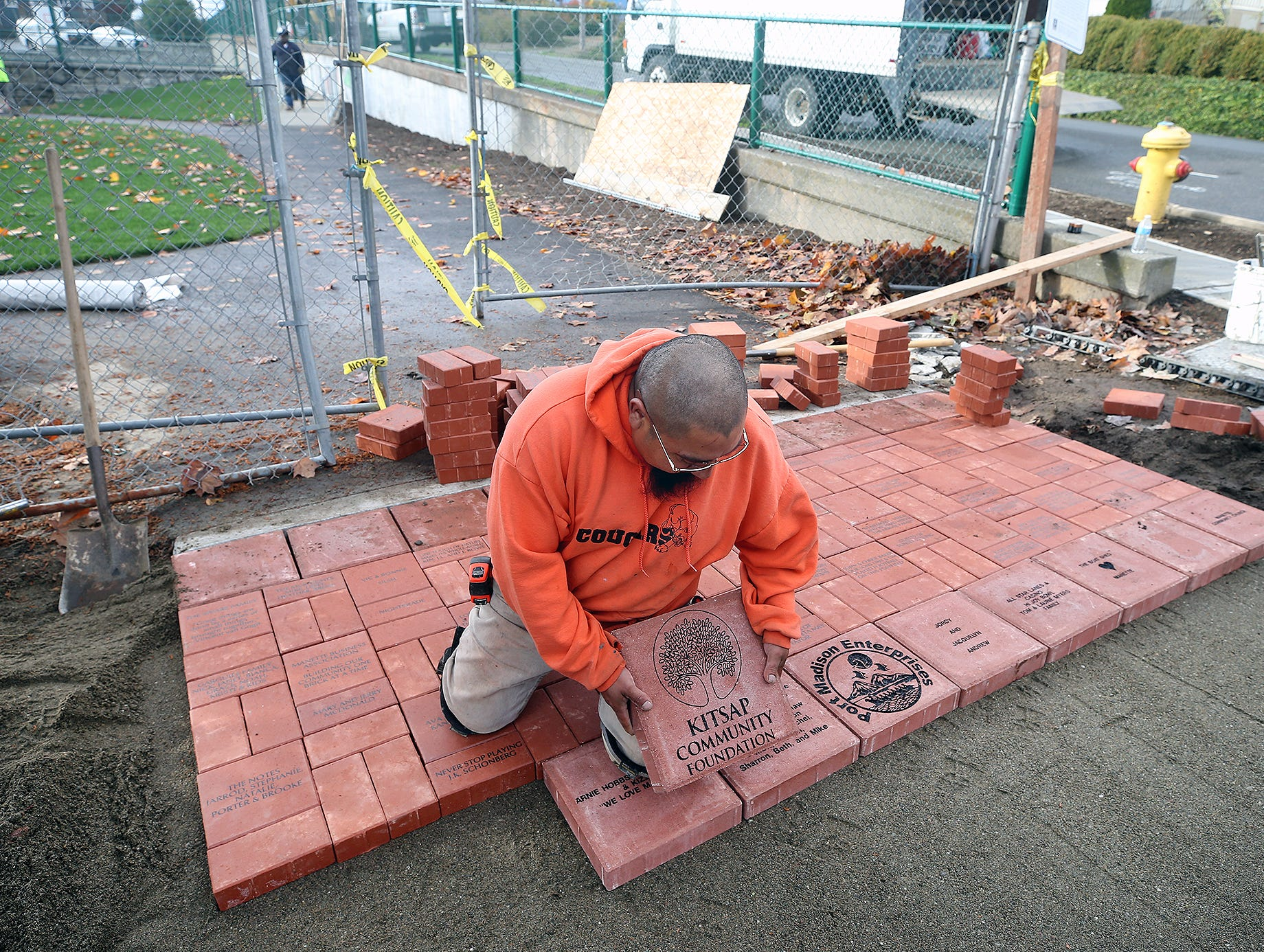 Isaac Cuevas from Yamamoto Landscaping lays down the donors bricks at the new Manette Playfield on Monday, October, 29, 2018.