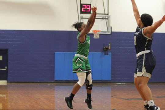 "Warren Wilson senior Danasia ""Piggy"" Dumas hits on 3 of her 36 points against Montreat College on Oct. 27."