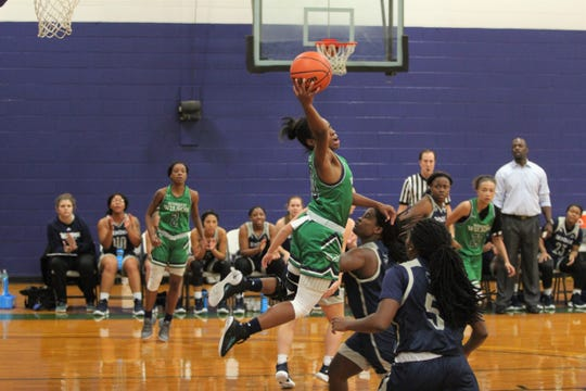 """Danasia """"Piggy"""" Dumas elevates for a rebound against the Montreat College Cavaliers in the Oct. 27 season opener for the Owls."""