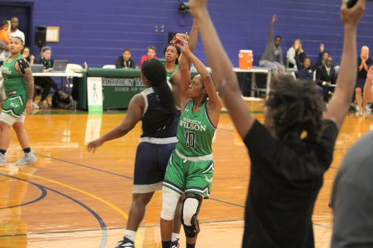 """Danasia """"Piggy"""" Dumas knocks down a three-pointer with a defender in her face on Oct. 27 against Montreat College."""