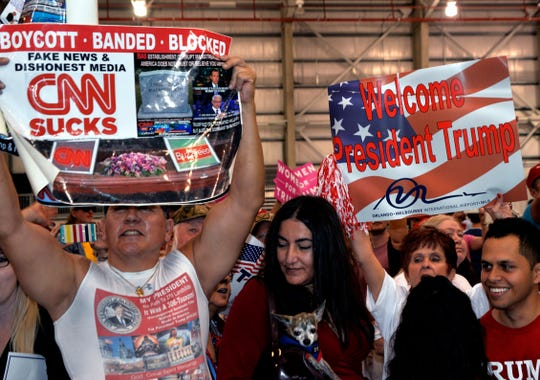 Accused pipe bomber Cesar Sayoc was photographed holding an anti-CNN sign at a 2017 Trump rally in Melbourne.