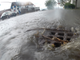"""Rainwater floods into a storm drain at Battery and King streets in Burlington on Aug. 7, 2017. The city subsequently overhauled drain systems at the intersection, and water flows are less """"flashy."""" Below-ground storage tanks in the area also slow rainfall's passage to the wastewater treatment plant."""