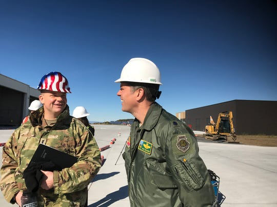 Lt. Mikel Arcovitch, left, speaks to Lt. Col. Nate Graber on Oct. 26, 2018 while giving a tour of new facilities built for the coming F-35 jet