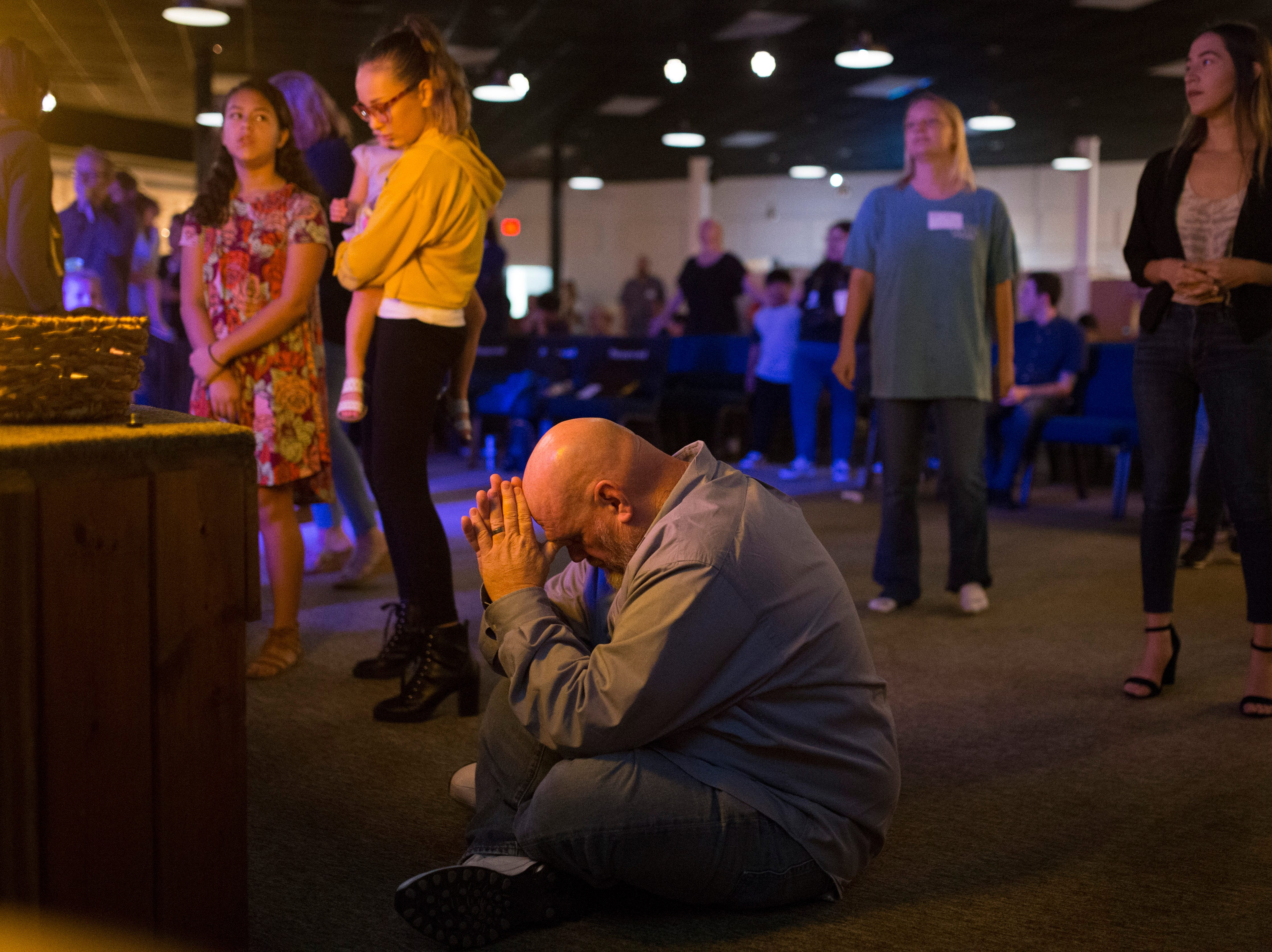 Troy Walters prays at church on Wednesday, Oct. 24, 2018 in Corpus Christi. Walters has seen firsthand the toll drug addiction can take on a family. He's also a drug counselor for South Texas Substance Abuse Recovery Services.