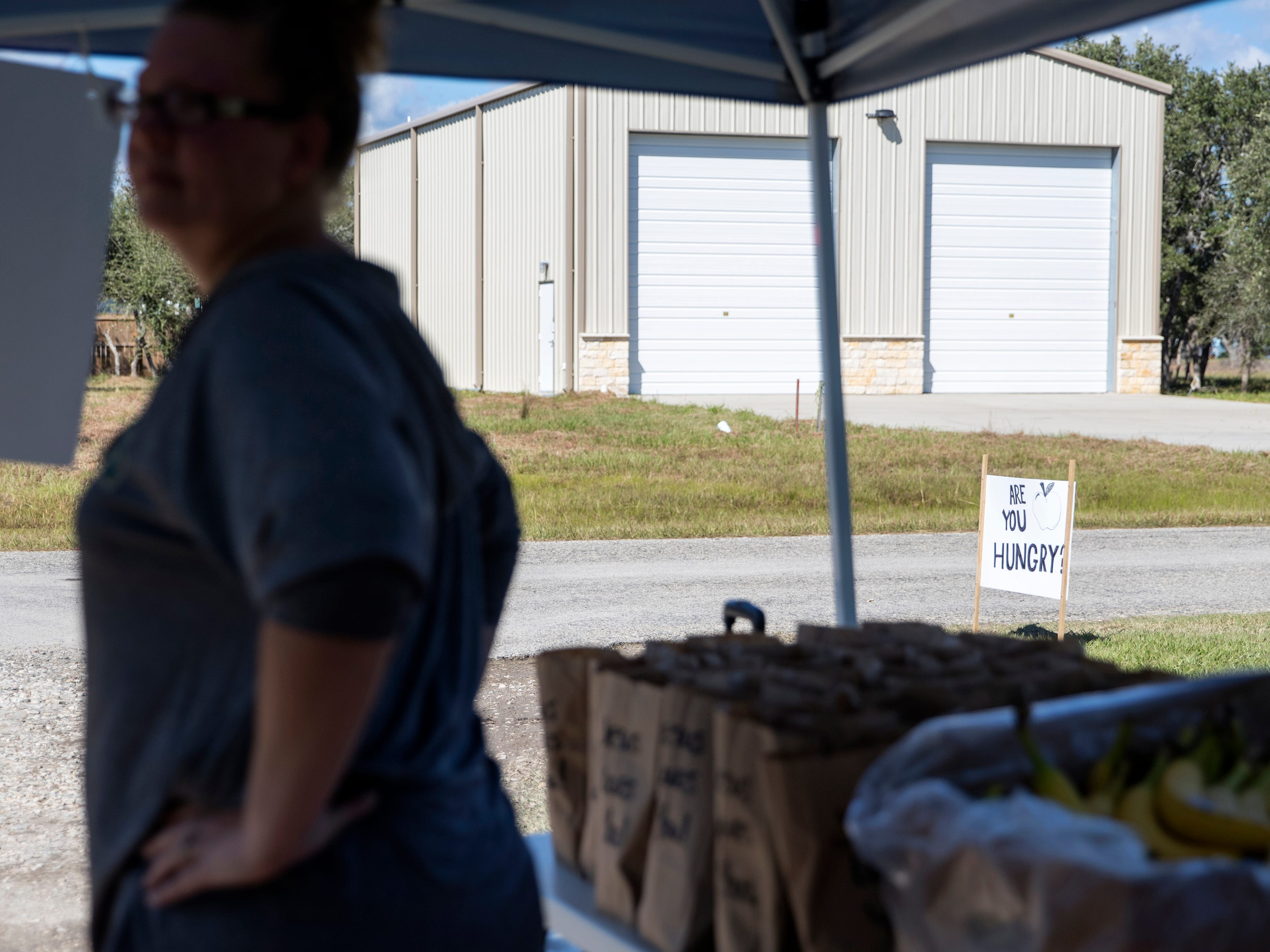 DeeDee Kilough gives away lunches from the end of her driveway at her home in Rockport on Monday, October 29, 2018. It is the second time she has given away lunches and the latest sack lunch also contained baked goods made by a friend. She said as a Christian she felt the need to give back to the community.