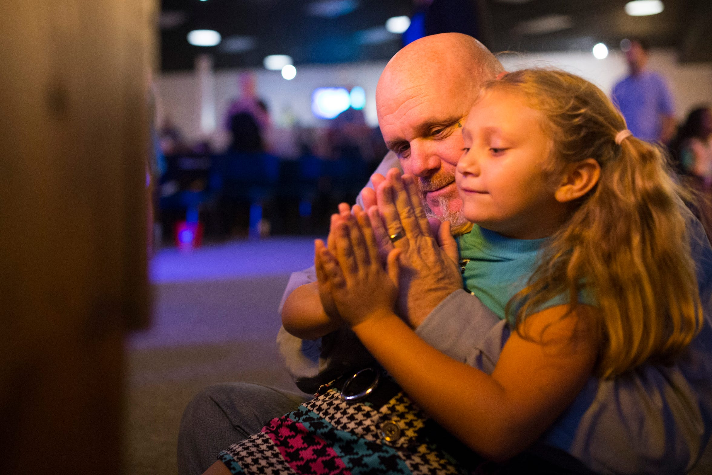 Troy Walters prays at church with Karah's daughter Jayde.