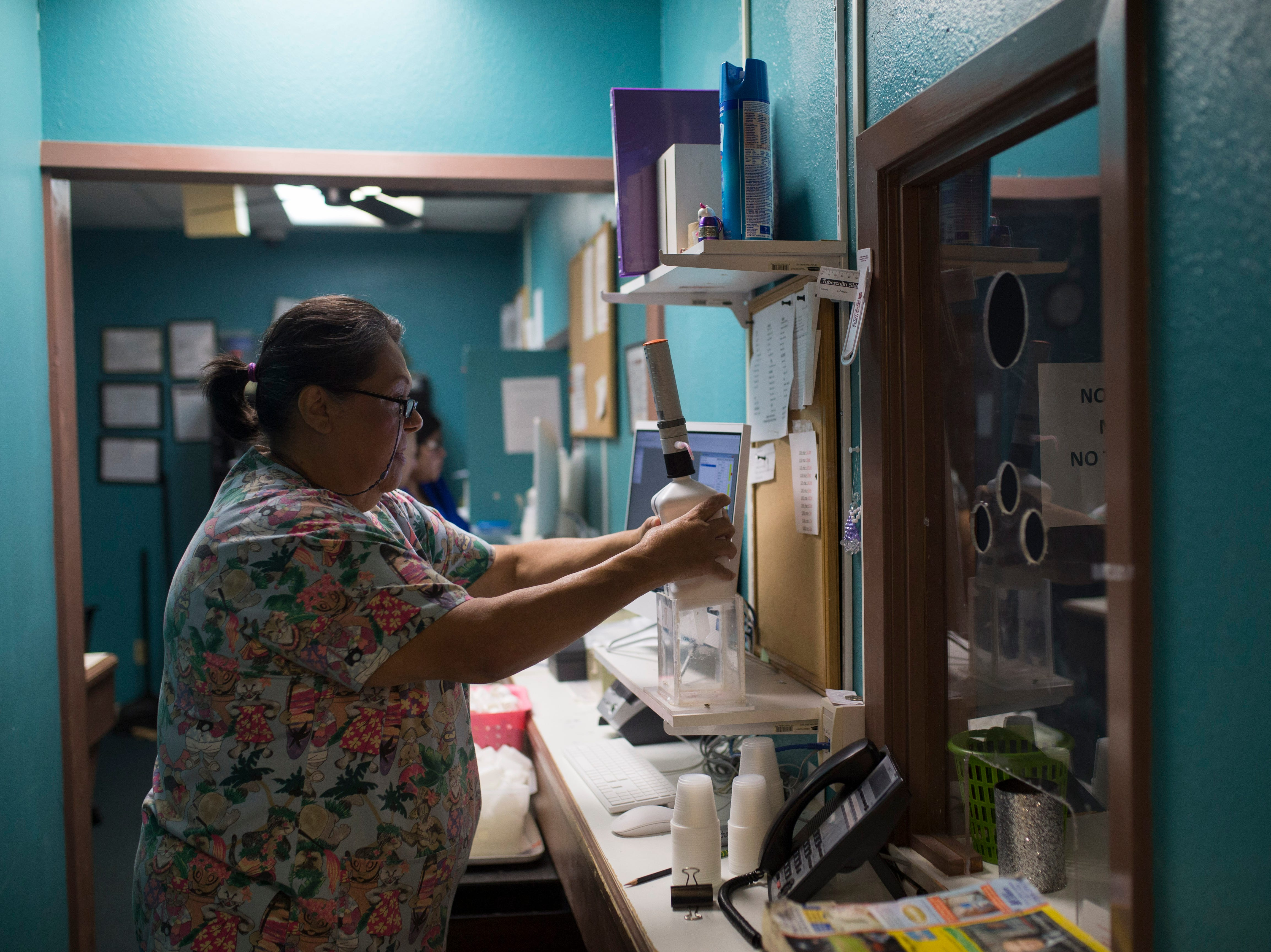 Methadone clinic workers prepare for their shift early in the morning at the S.T.A.R.S. clinic in Corpus Christi.
