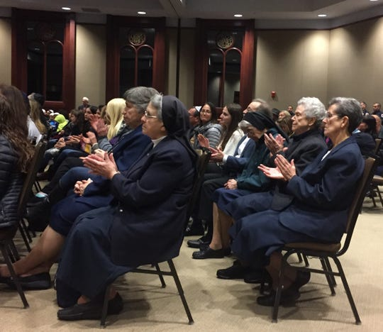 Members of multiple faiths attended a vigil in Voorhees on Sunday night that mourned victims of an anti-Semitic attack.