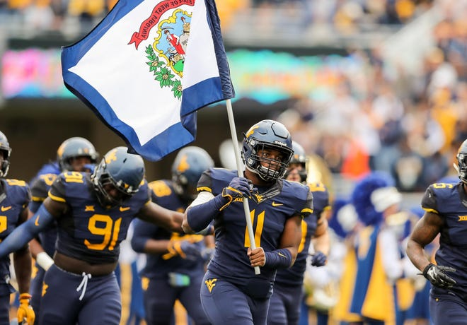 West Virginia's David Long Jr. (11), a Winton Woods High School grad, has68 total tackles, four sacks and 12.5 tackles for loss this season.