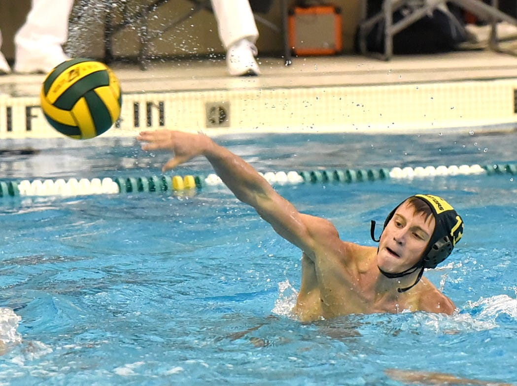 Pierce Ellingson makes a shot on goal for Sycamore in the boys state water polo semifinal game, October 27, 2018.