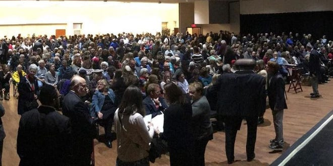 Community members gather in Cincinnati for a vigil for the victims of the synagogue shooting in Pittsburgh.