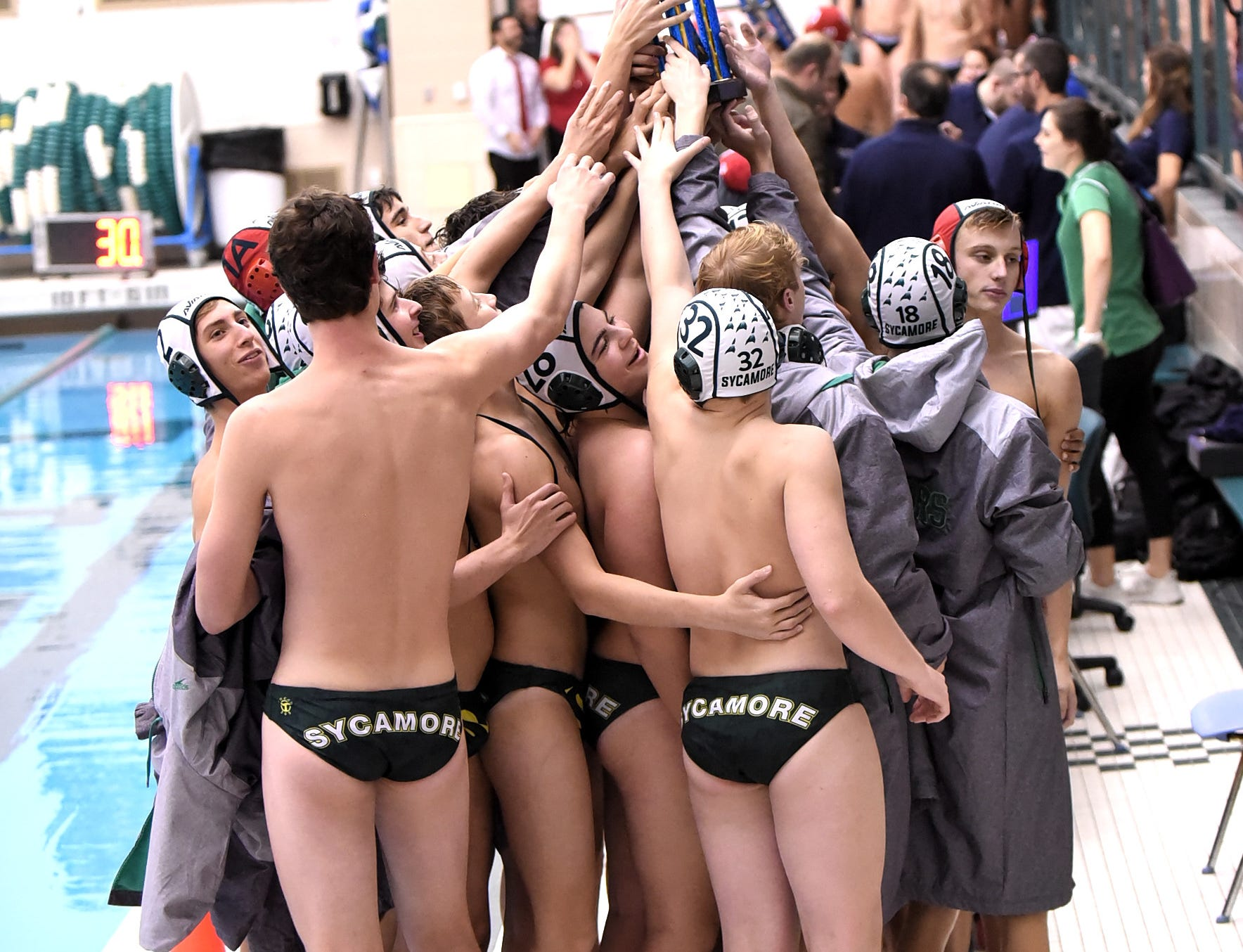 The Aviators raise the state boys water polo runners-up trophy with pride for the Sycamore nation, October 27, 2018.