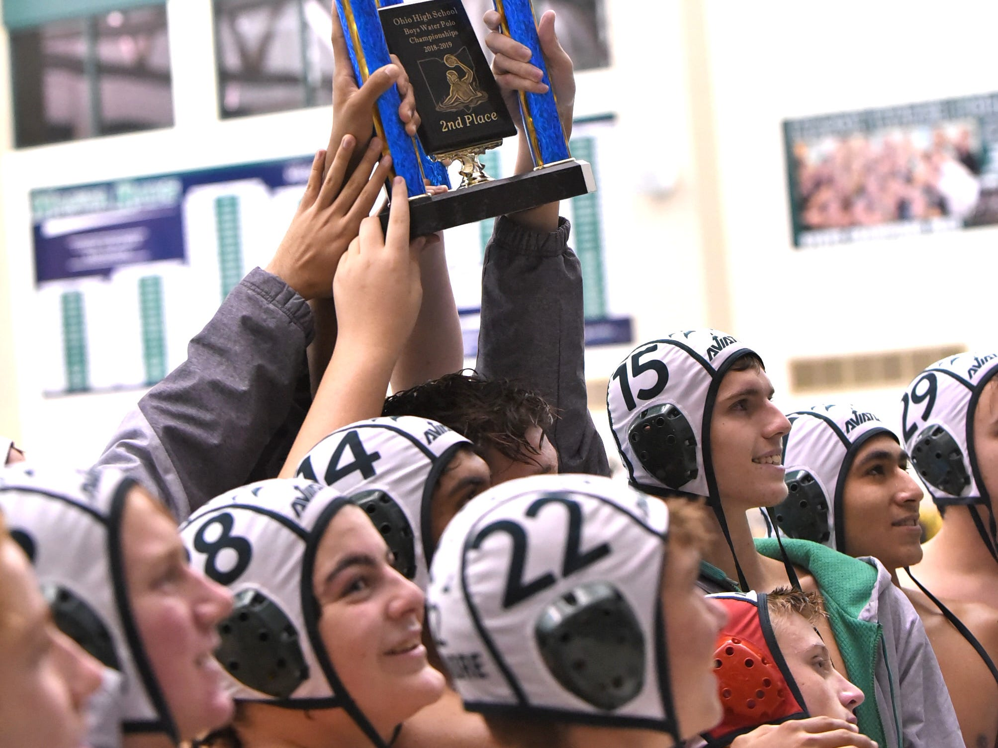Captains for Sycamore Aviator water polo show off the state second-place trophy, October 27, 2018.