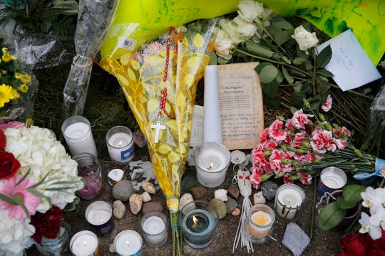 A memorial on the sidewalk on Wilkins Avenue near the Tree of Life Synagogue in the Squirrel Hill neighborhood of Pittsburgh Monday, October 29, 2018. Eleven people were killed and six other people were wounded on Saturday at the synagogue. Robert Bowers allegedly burst into the Tree of Life Congregation Synagogue and screamed anti-Semitic epithets, as he opened fire on the congregants, law enforcement officials said.