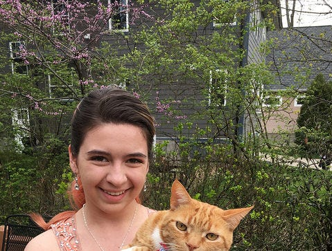 Carl Weiser's daughter Lila had the purr-fect prom date, cat Squiggles/Schnecken.