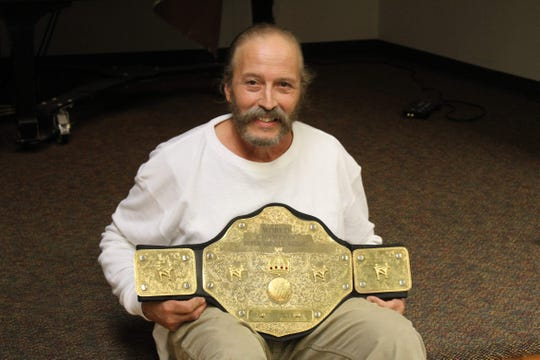 Robert Rodriguez, of Flemington, posing with his World Championship Kickboxing belt, which he won in 2005.