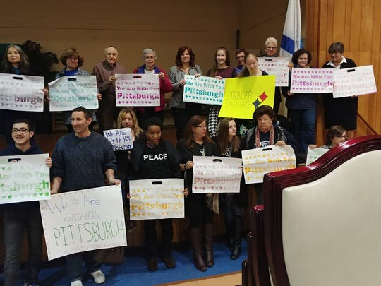 "Coming together as a sign of support and unity, more than 600 residents, community and faith leaders participated in an interfaith community gathering called ""Together for Pittsburgh — Rising Against Hatred"" at Neve Shalom in Metuchen."