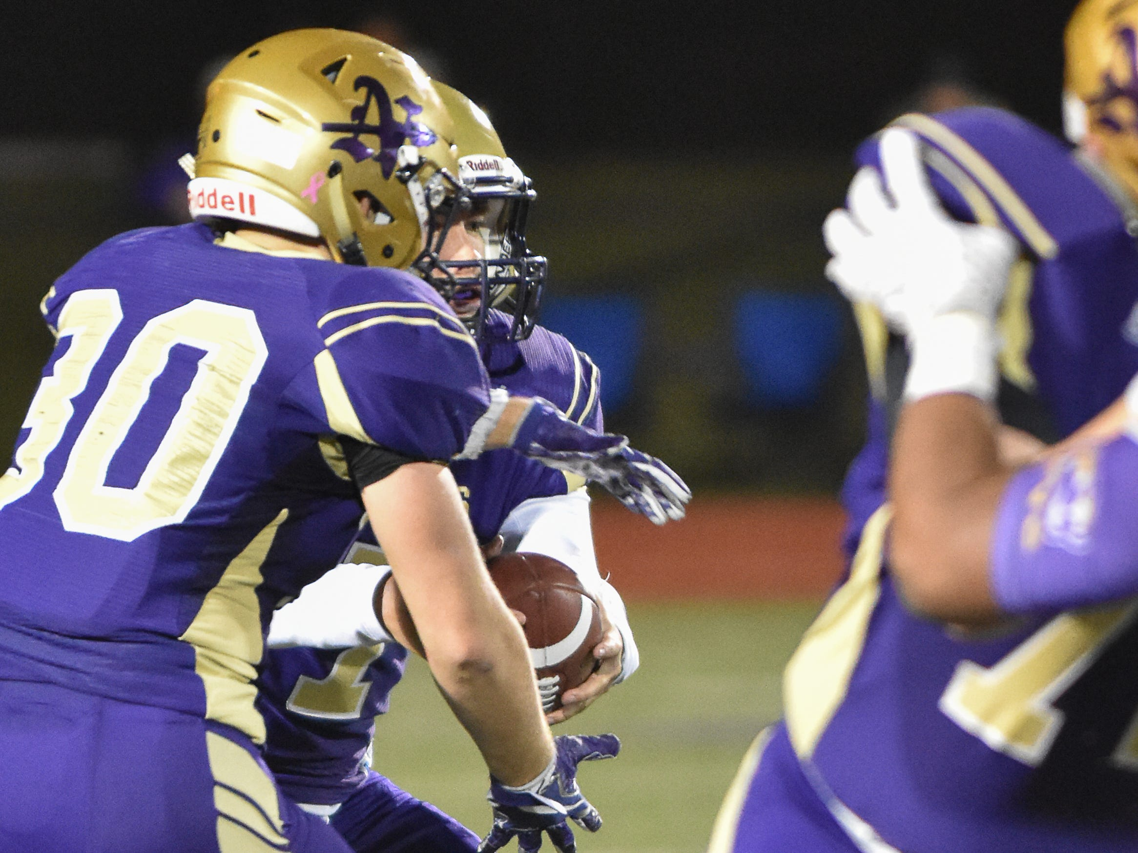 Norwalk's Max Sutcliffe fakes a hand off to Christian Nicholson during a first-round playoff game Friday in Norwalk. Spencer ended Norwalk's season Oct. 26, 2018, with a 24-20 win in the first round of the Class 3A playoffs.