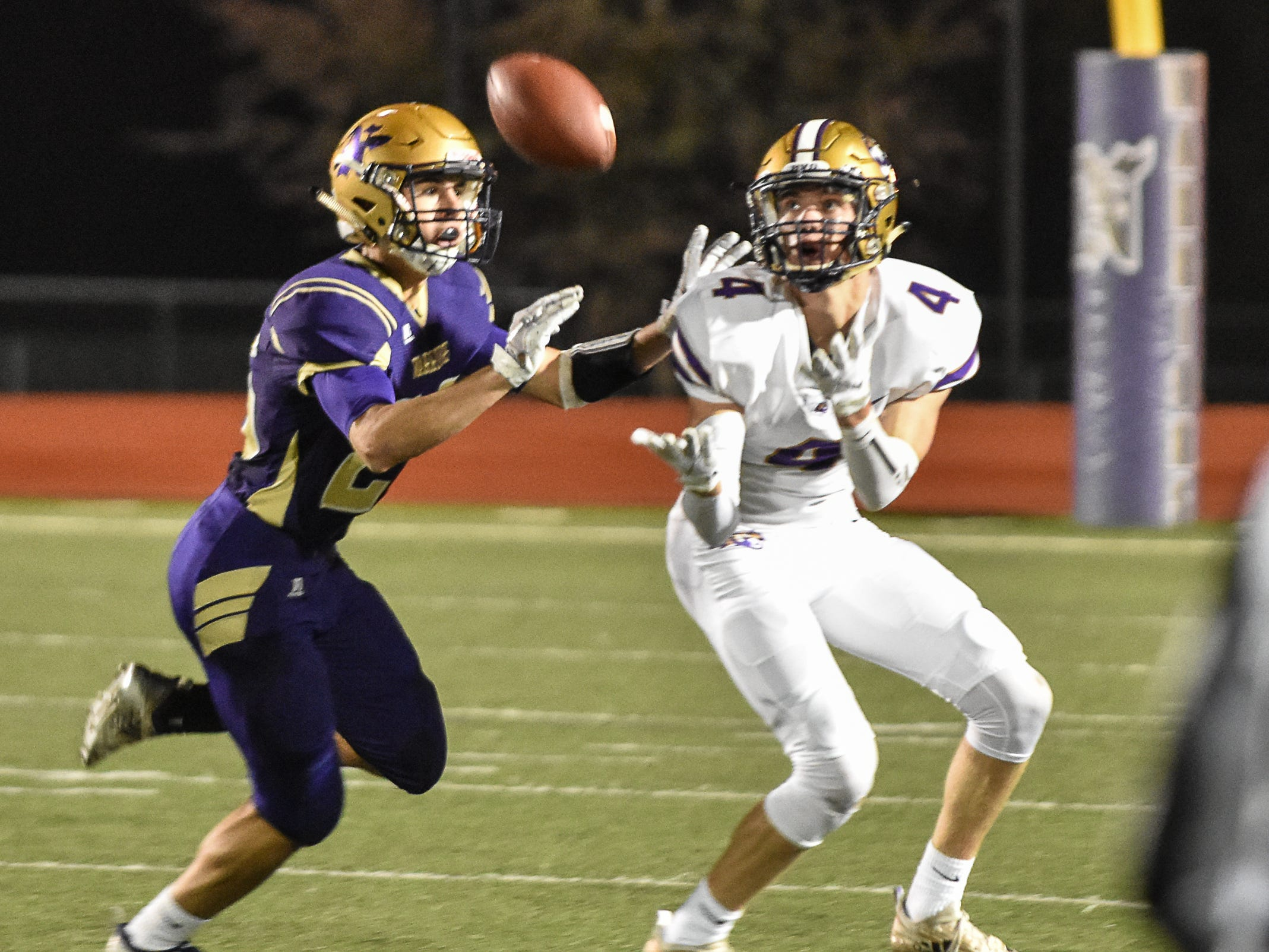 Norwalk's Carson Raper covers a pass to Spencer's Michael Storey during a first-round playoff game Friday in Norwalk. Spencer ended Norwalk's season Oct. 26, 2018, with a 24-20 win in the first round of the Class 3A playoffs.