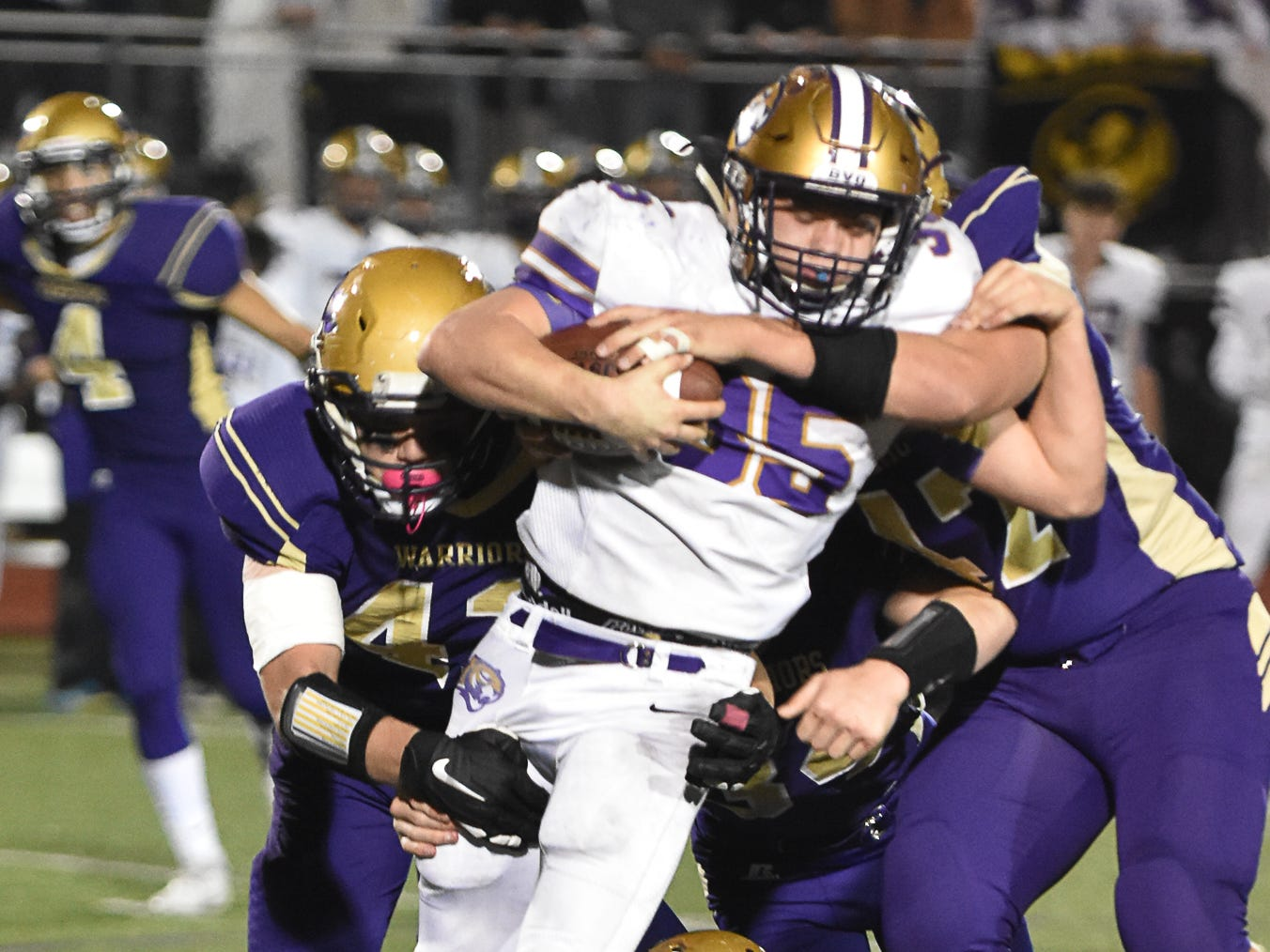 Norwalk defenders tackle Spencer's Isaiah Spencer during a first-round playoff game Friday in Norwalk. Spencer ended Norwalk's season Oct. 26, 2018, with a 24-20 win in the first round of the Class 3A playoffs.