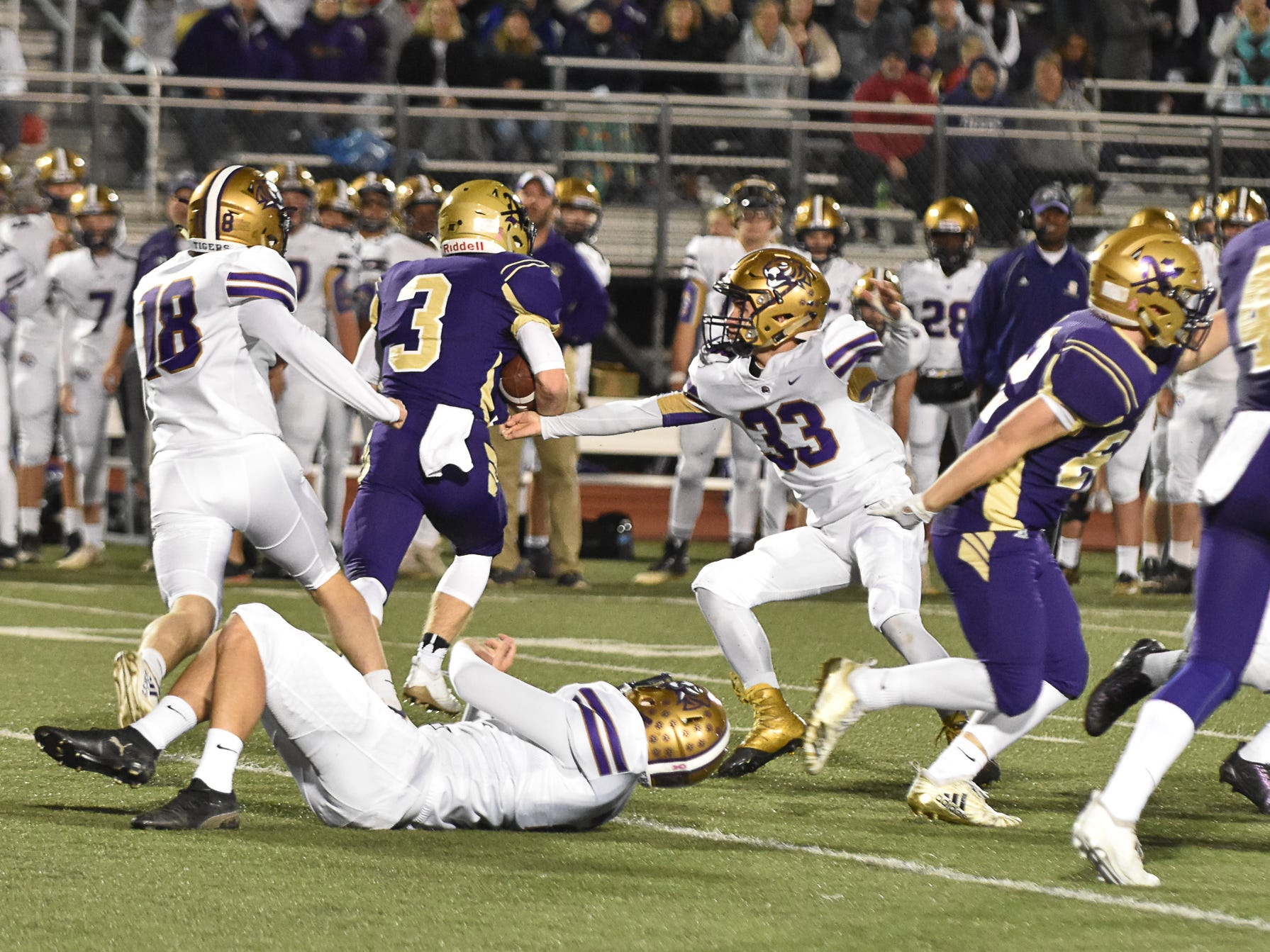 Norwalk's Scott Anderson breaks free of the pack headed for a touchdown during a first-round playoff game Friday in Norwalk. Spencer ended Norwalk's season Oct. 26, 2018, with a 24-20 win in the first round of the Class 3A playoffs.