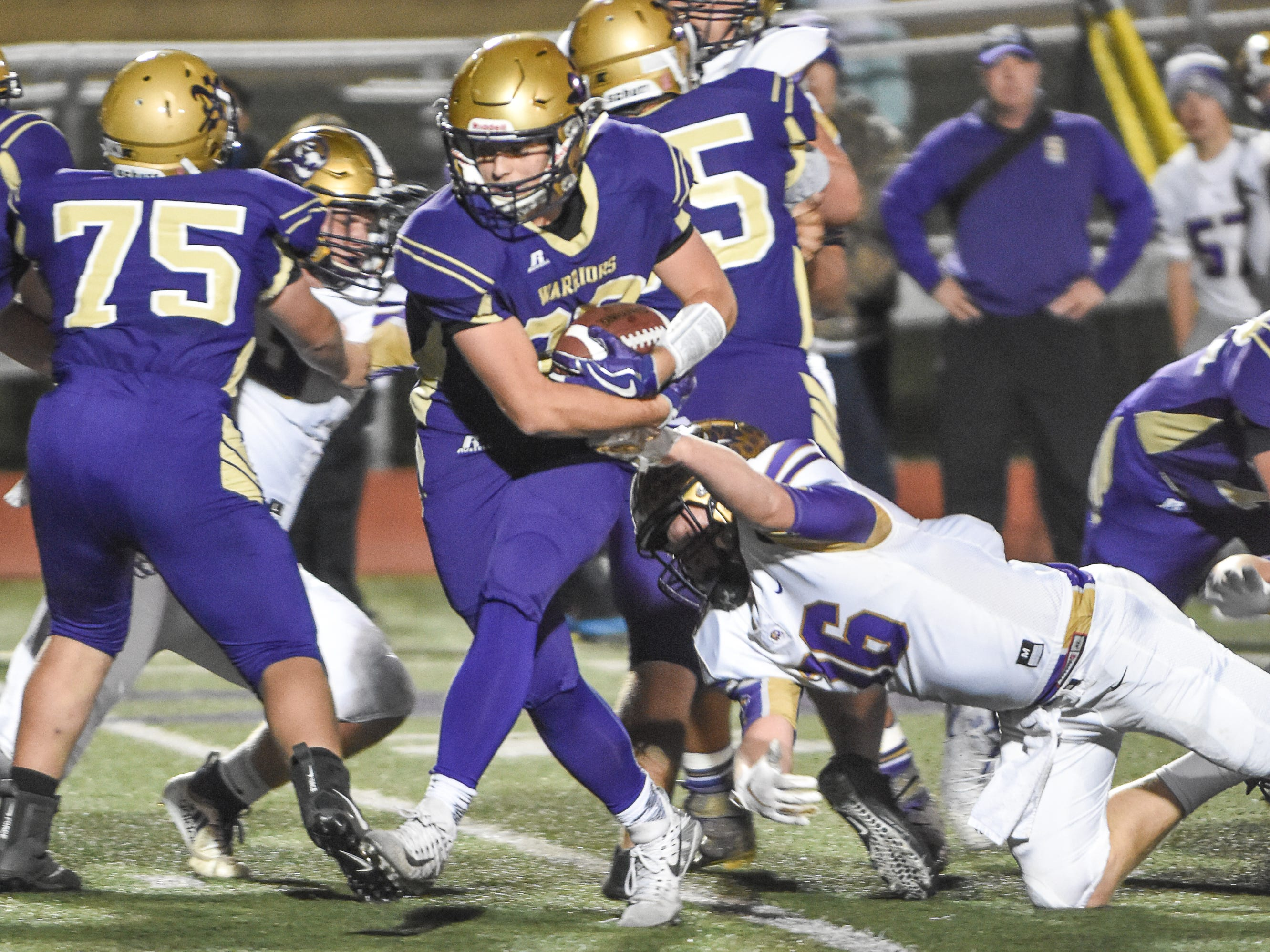 Norwalk's Christian Nicholson shakes off a tackle on his way to a touchdown during a first-round playoff game Friday in Norwalk. Spencer ended Norwalk's season Oct. 26, 2018, with a 24-20 win in the first round of the Class 3A playoffs.