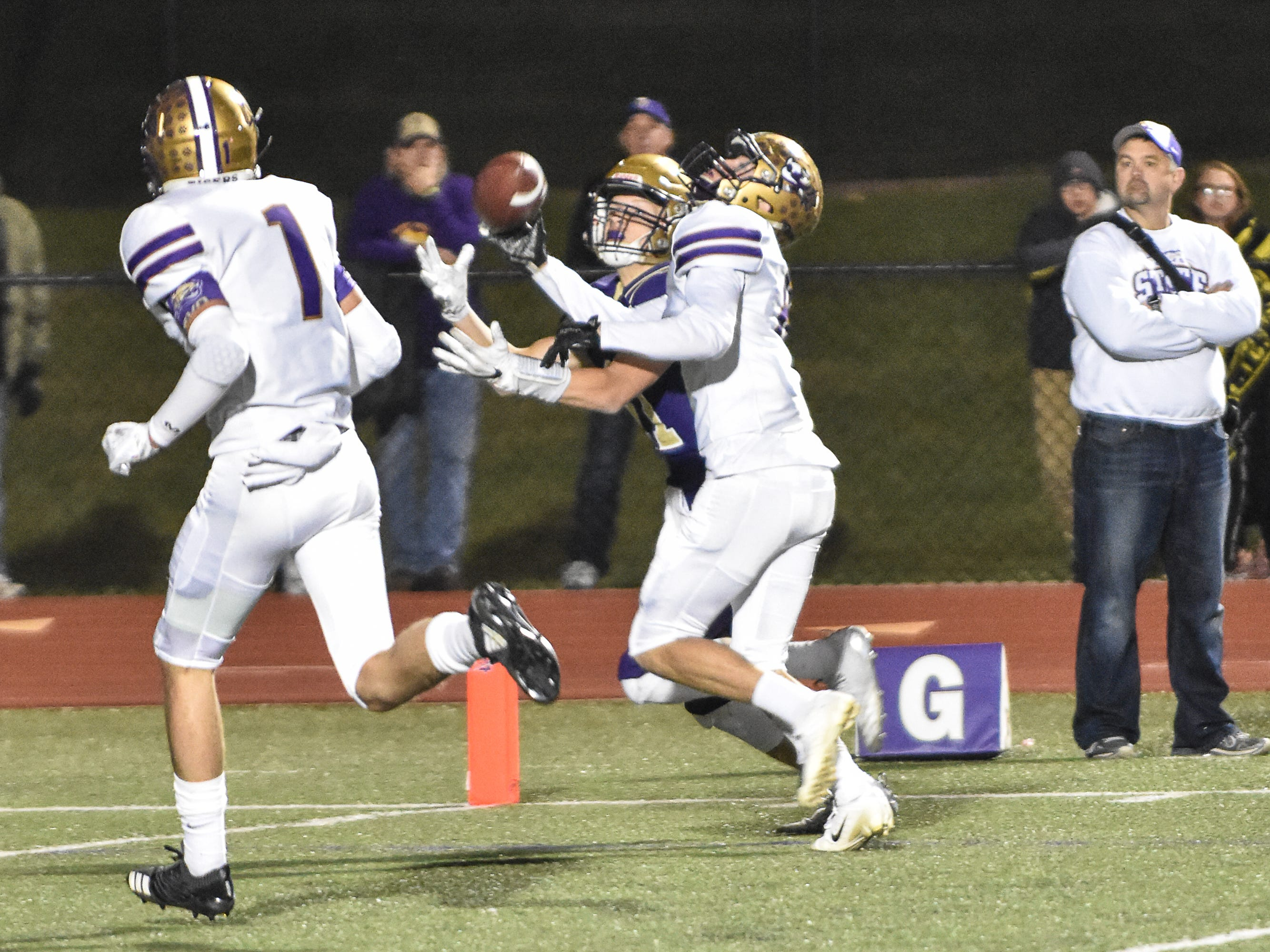 Spencer's Kyle Morony blocks a pass to Norwalk's Zach Marker during a first-round playoff game Friday in Norwalk. Spencer ended Norwalk's season Oct. 26, 2018, with a 24-20 win in the first round of the Class 3A playoffs.