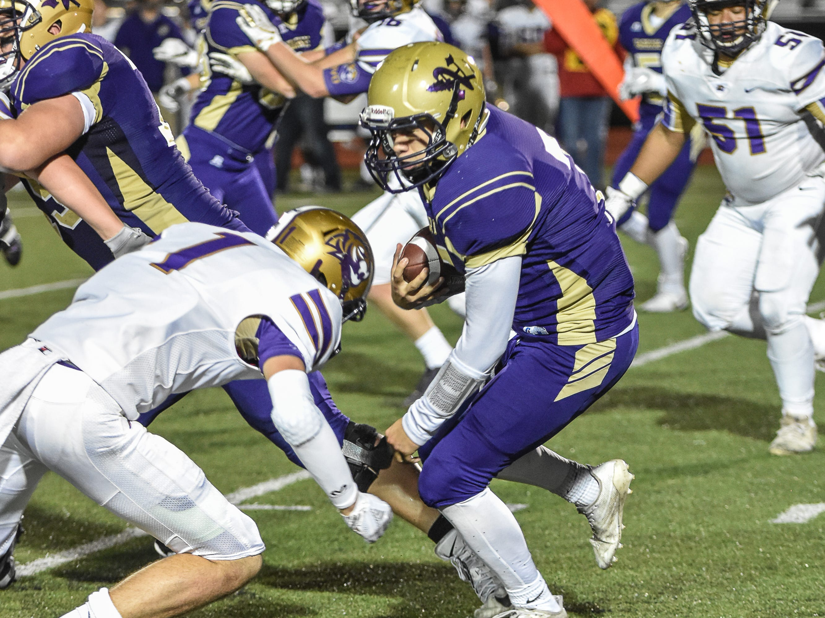 Norwalk's Max Sutcliffe rushes during a first-round playoff game against Spencer on Friday in Norwalk. Spencer ended Norwalk's season Oct. 26, 2018, with a 24-20 win in the first round of the Class 3A playoffs.
