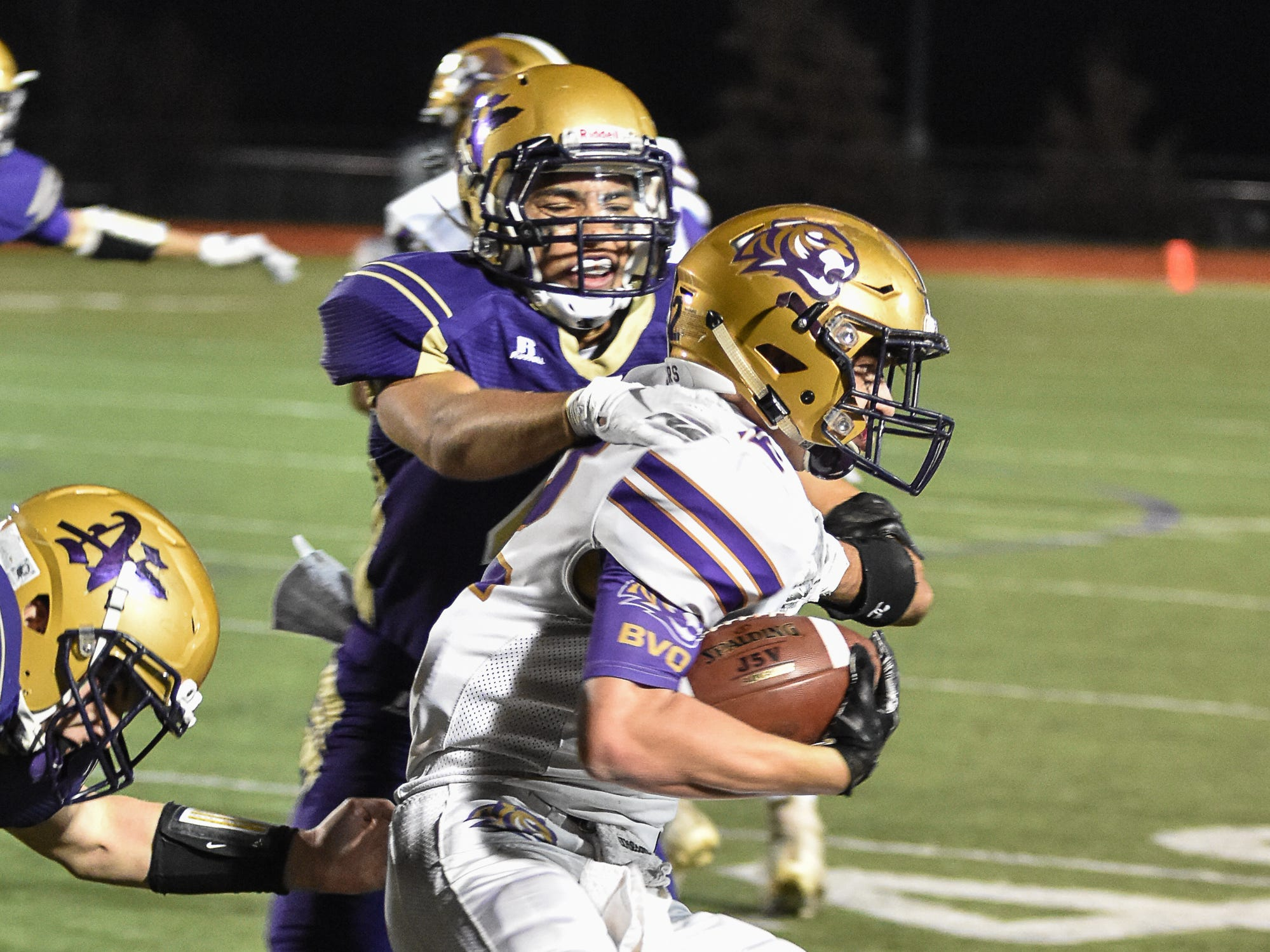 Norwalk's Nate Spurr and Dylan Wolfe tackle Spencer's Isaac Pingel during a first-round playoff game Friday in Norwalk. Spencer ended Norwalk's season Oct. 26, 2018, with a 24-20 win in the first round of the Class 3A playoffs.