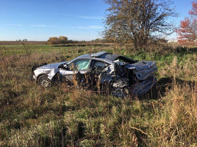An Iowa State Patrol vehicle was struck Monday morning on Highway 163.