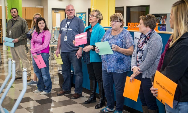 Scavo High School staff guess what is the median age for the onset of mental illnesses during a Youth Mental Health First Aiders workshop Thursday, October 25, 2018, in Des Moines.