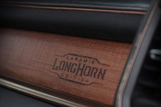 It's the little details that matter. The glove box of a 2019 Ram 1500 Laramie Longhorn is marked by a branding iron to show customers they have something special.