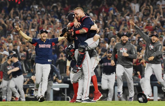 Christian Vazquez #7 jumps into the arms of Chris Sale #41 of the Boston Red Sox to celebrate their 5-1 win over the Los Angeles Dodgers in Game Five to win the 2018 World Series at Dodger Stadium on October 28, 2018 in Los Angeles, California.