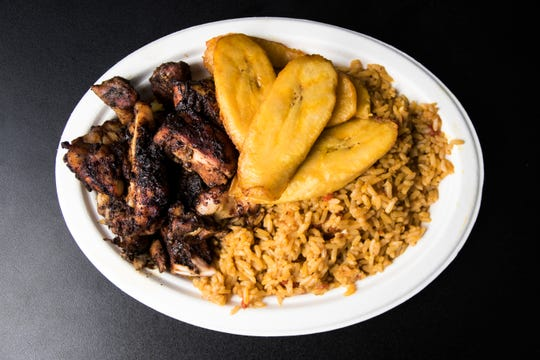 The Classic combo from YumVillage features jollof rice, jerk chicken and plantains.