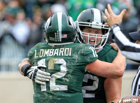 Michigan State got a much-needed win against Purdue, on the arm of redshirt freshman QB Rocky Lombardi. How high did the Spartans jump in the Free Press' Big Ten power rankings? And is Michigan still No. 1?