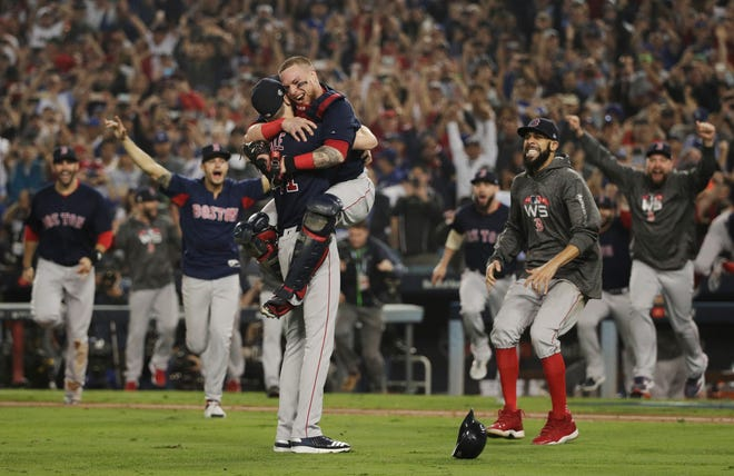 The Boston Red Sox celebrate after beating the Los Angeles Dodgers, 5-1, on Sunday and winning the World Series in the five games.