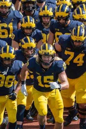 """Michigan defensive end Chase Winovich (15) says the Wolverines are on a """"Revenge Tour."""""""