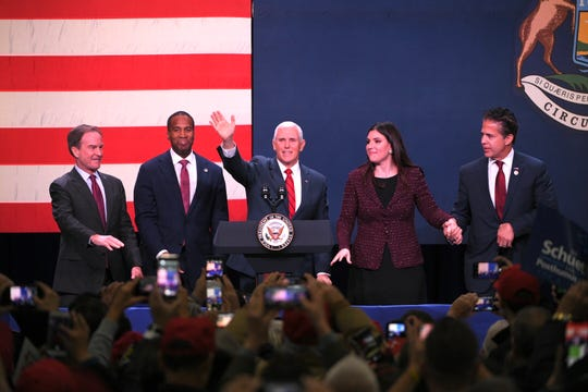 Michigan attorney general and Republican gubernatorial candidate Bill Schuette, from left, U.S. Senate candidate John James, Vice President Mike Pence, congressional candidate Lena Epstein and incumbent and candidate for re-election U.S. Rep. Mike Bishop, R-Rochester, stand together on stage during a campaign event at the Oakland County airport Monday in Waterford.