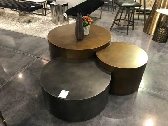 Interlocking black and brass tables make a modern and pimactful statement. (Design Recipes)