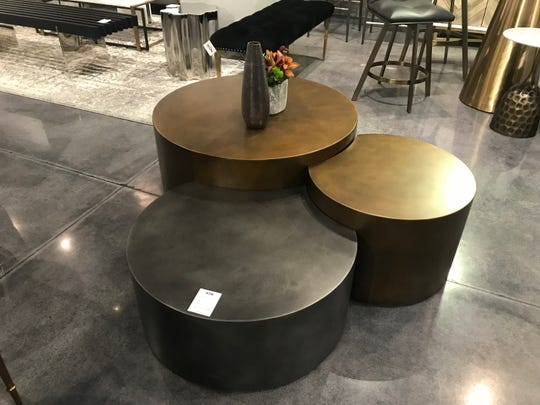 Interlocking black and brass tables make a modern and pimactful statement. (Design Recipes)