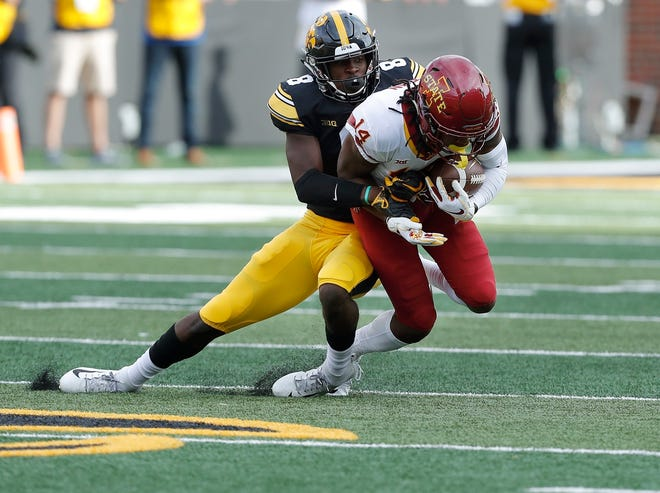 Iowa defensive back Matt Hankins, left, tackles Iowa State wide receiver Tarique Milton during a game earlier this season.