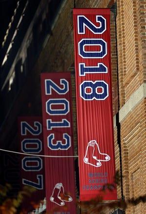 The 2018 World Series baseball championship banner hangs outside Fenway Park.