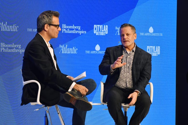 Richard Florida, co-founder and editor at- large of CityLab.com and senior editor of The Atlantic talks with Dan Gilbert, founder of Quicken Loans, during Citylab Detroit at the Marriott Renaissance Center on Monday.
