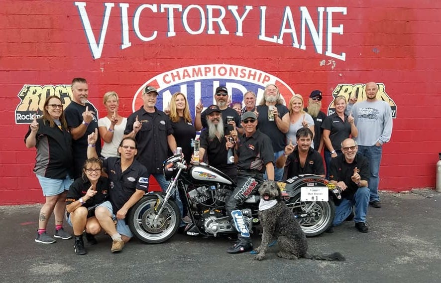 "Evansville's Dave ""Paco"" Cartwright sits in the winners circle after breaking a quarter-mile record at Rockingham Dragway in North Carolina."