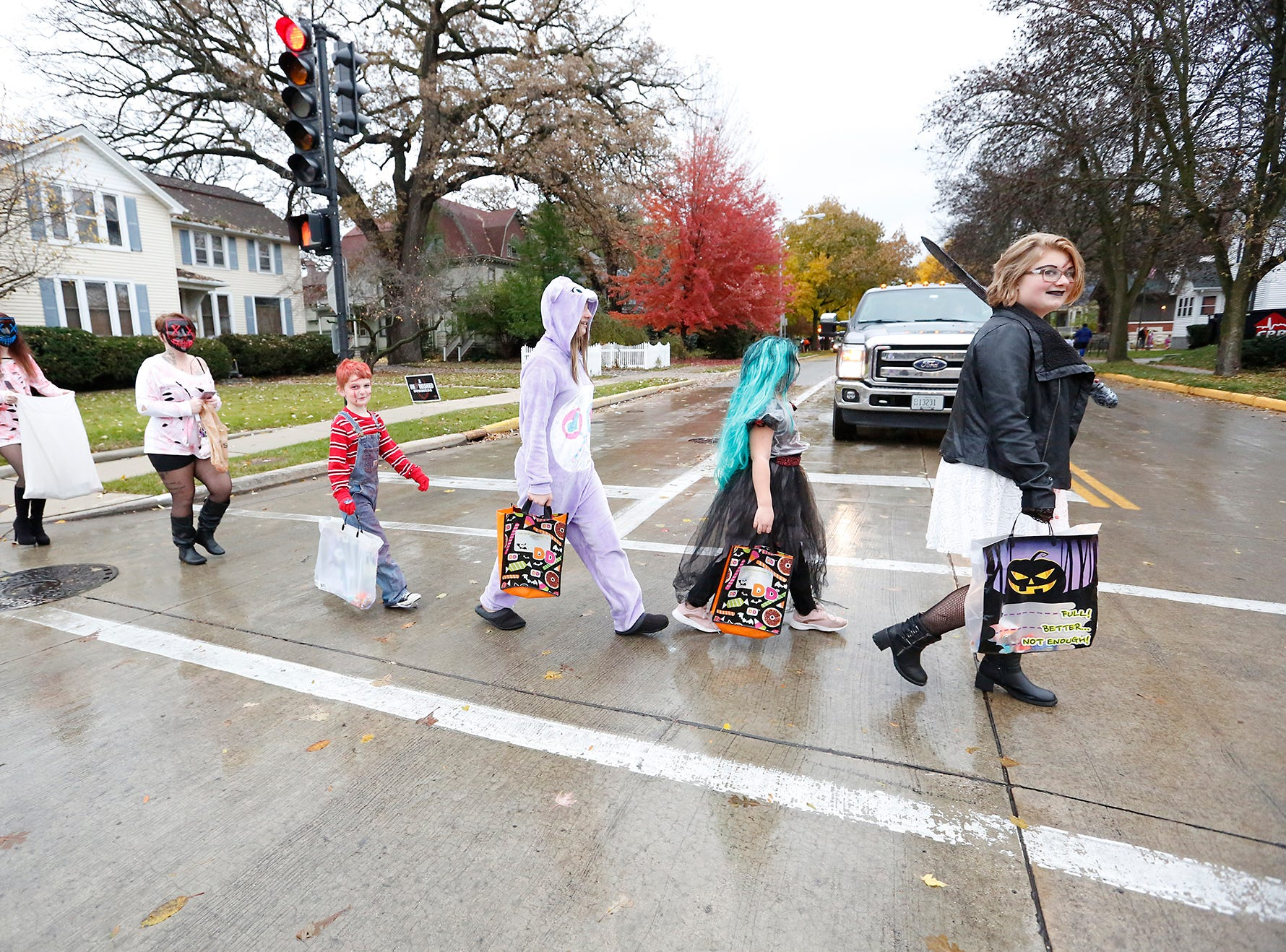 Desiree Snyder, Michelle Snow, Channing Snyder, Mekenna and Lexi Cazett and Lily Crowell of Fond du Lac walk along Park Avenue Sunday, October 28, 2018 in Fond du Lac, Wisconsin while trick or treating. Doug Raflik/USA TODAY NETWORK-Wisconsin
