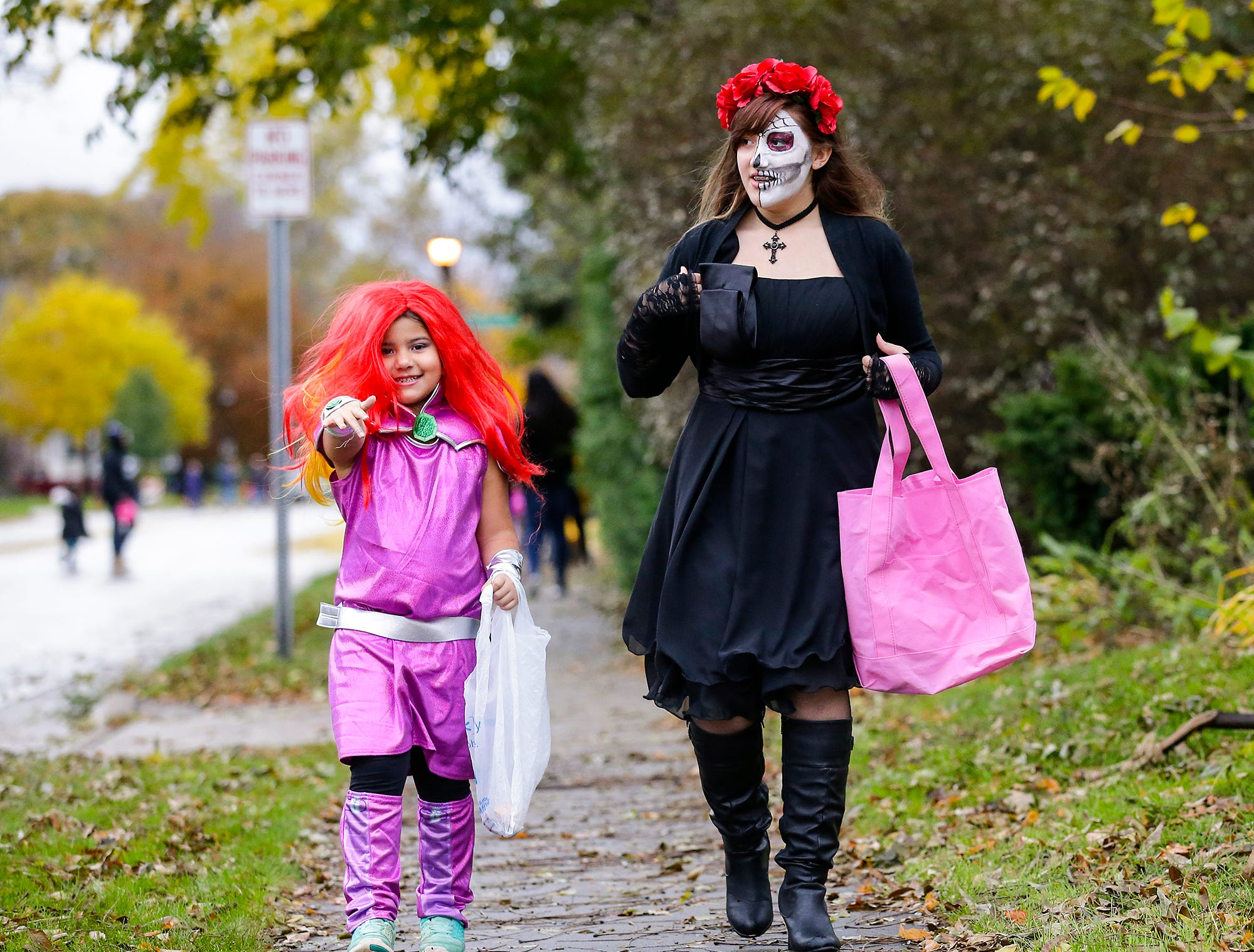 Yesenia Arriaga and Brooke Waterman of Fond du Lac were out trick or treating Sunday, October 28, 2018 in Fond du Lac, Wisconsin. Doug Raflik/USA TODAY NETWORK-Wisconsin